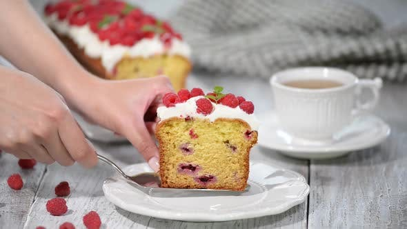 Thumbnail for A Slice of Summer Pound Cake with Raspberries Topped with Sugar Glaze.