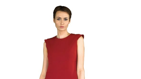 Thumbnail for Girl in A Red Dress Posing, Straightens Her Dress on White