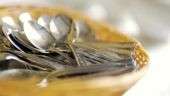 Cover Image for Several Spoons in Wooden Basket on Table