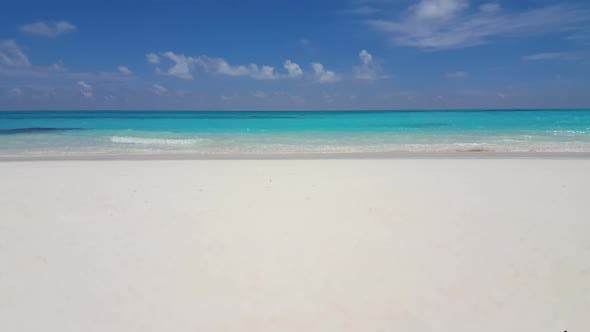Thumbnail for Beautiful fly over island view of a white paradise beach and aqua blue ocean background in 4K