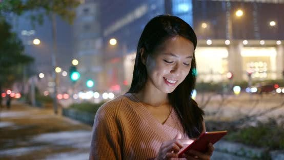 Thumbnail for Woman use of mobile phone at night
