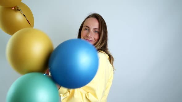 Thumbnail for Beauty Woman with Colorful Air Balloons Spinning and Laughing. Beautiful Happy Young Woman