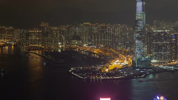 Hong Kong Urban Cityscape Aerial Skyline Panorama Timelapse at Night Pan Up