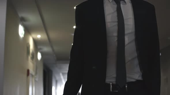 Thumbnail for Businessman Walking with Luggage in Hotel