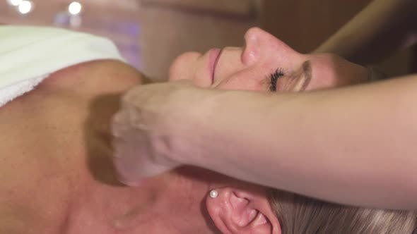 Thumbnail for A Tired Woman Is Given a Face Massage