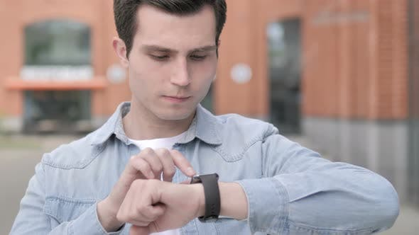 Thumbnail for Young Man Using Smartwatch Outdoor