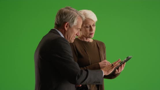Thumbnail for Business team going over financial data on tablet in the hallway on green screen