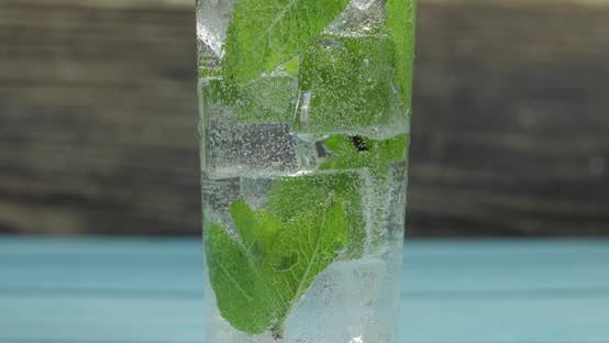 Thumbnail for Clear Water in Glass with Green Mint Leaves and Ice Cubes