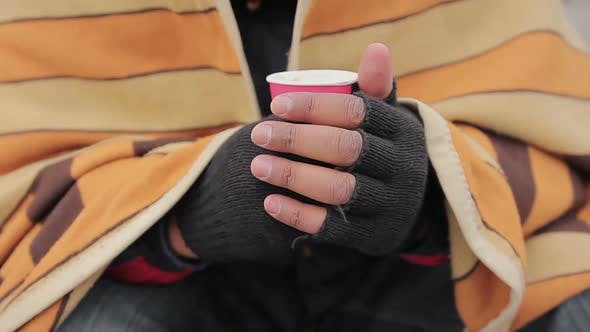 Thumbnail for Needy Person's Hands Holding Warm Drink in Paper Cup