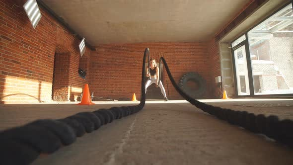 Thumbnail for Active Fit Female Athlet Is Doing Battle Rope.