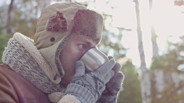 Thumbnail for Man Enjoying Hot Tea in Winter