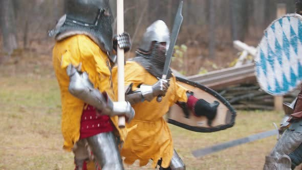 Cover Image for Four Men Knightes Having a Training Fight Outdoors