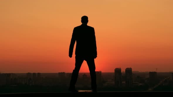 Thumbnail for Successful Businessman Looking at the Town at the Dawn
