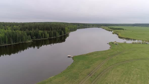 Thumbnail for 01. Aerial view of small lake with equipped fishing piers