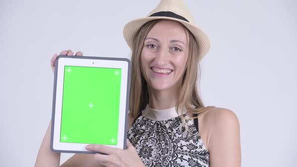 Thumbnail for Face of Happy Blonde Tourist Woman Showing Digital Tablet