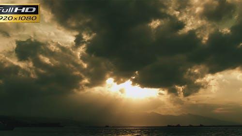 Dark Clouds In The Sunset