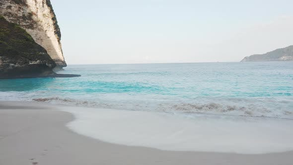 Thumbnail for Beautiful Seascape Paradise with Ocean Waters on the Sandy Shores and Mountainous Cliff