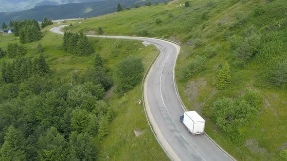 Thumbnail for White Delivery Truck or Van Driving Down the Mountain Road. Logistic Transport Semi Truck Lorry