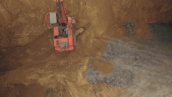 Aerial Shot of a Hyperlapse Excavator Digging