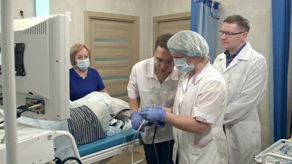Thumbnail for Medical Team Preparing for Endoscopic Surgery