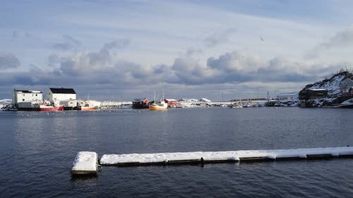 Norwegian Winter Landscape With The Multicolored Rorbu And Fishing Ships 35