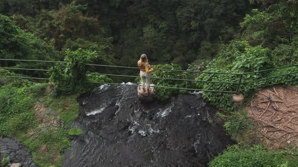 Thumbnail for Drone Over Tourist At Top Of Sekumpul Waterfall