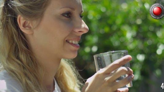 Blond Girl Drinks Water