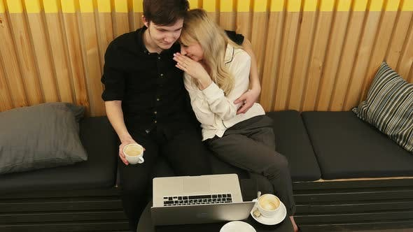 Thumbnail for Loving Couple Sitting in Drinking Coffee Enjoying Time Together