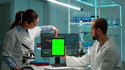 Medical Research Scientists Using Notepad with Green Screen