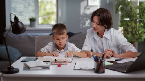 Boy with Tutor at Home