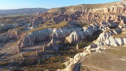 Hoodoos, Fairy Chimneys and Sedimentary Volcanic Rock Formations in Eroded Cappadocia Valley, Urgup