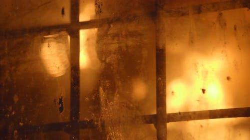 Blast Furnance Behind the Latticed Window at a Metallurgical Plant