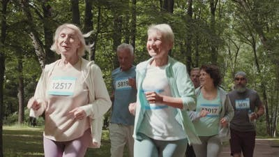 Several Old People Running in Park