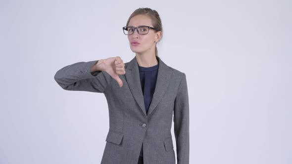 Thumbnail for Young Serious Businesswoman Giving Thumbs Down