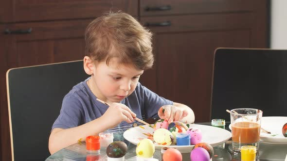 Thumbnail for Little Boy Decorating Easter Eggs for Holiday