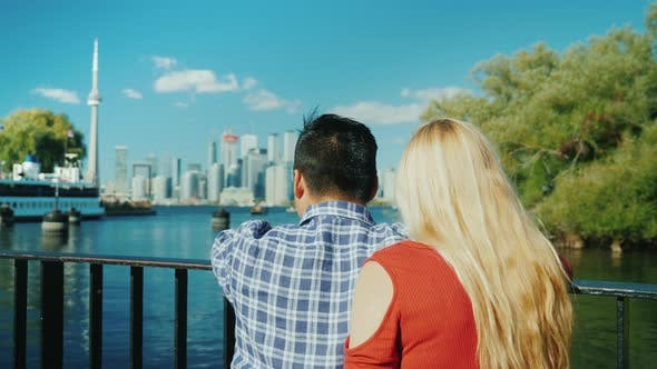 Thumbnail for A Young Couple Admiring the View of the City of Toronto in Canada