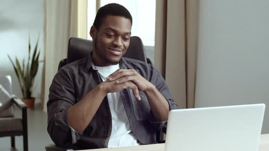 Thumbnail for Portrait of Afro American Man Resting Sitting at Table in Office or at Home in Front of Laptop