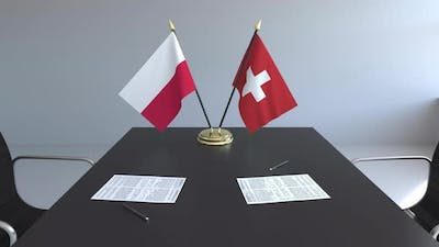 Flags of Poland and Switzerland on the Table