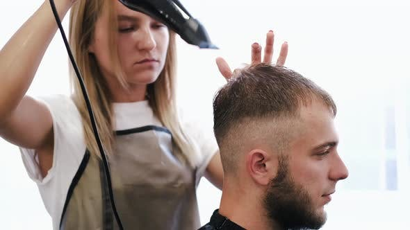 Thumbnail for Hairdresser Drying Client's Hair After Haircut in Salon