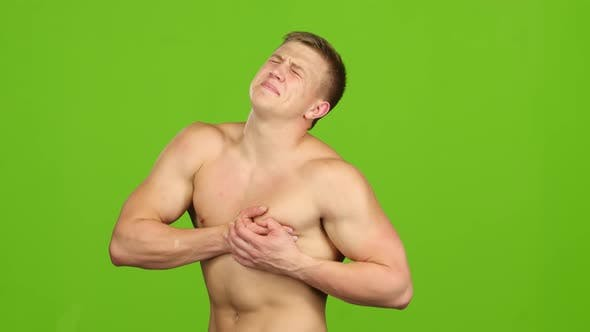 Thumbnail for Handsome Man Suffers From Pain in Heart on Green Screen