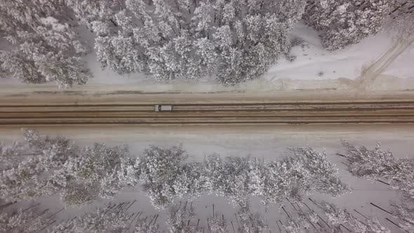 Thumbnail for Car On Winter Forest Road From Above