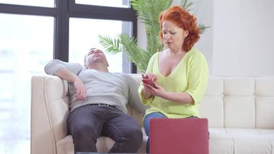 Jealous Wife Checking Phone of Sleeping Husband at Home