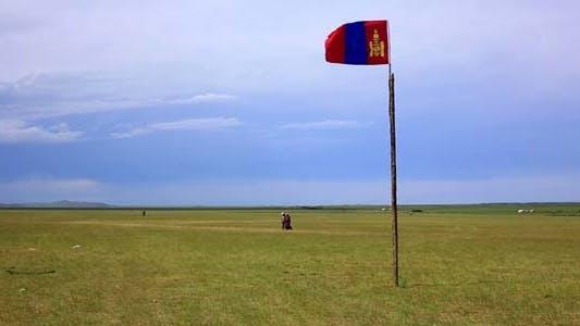 Mongolian Flag Flying Over Steppe