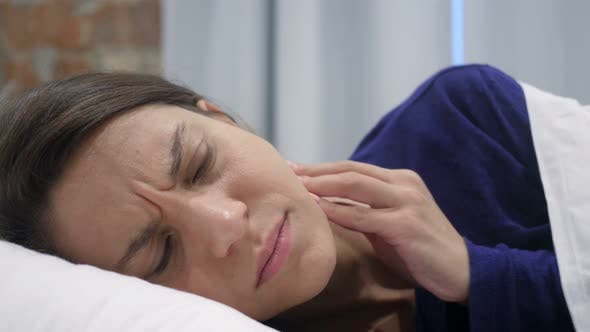 Thumbnail for Hispanic Woman Lying in Bed Suffering Toothache, Teeth Pain