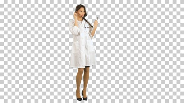 Funny female nurse playing with a stethoscope, Alpha Channel