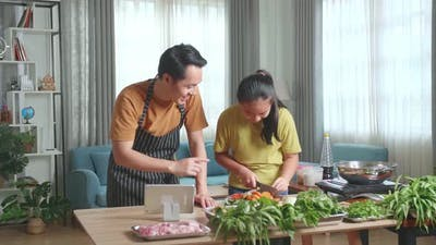 Asian Father Teach His Daughter How To Cook At Home