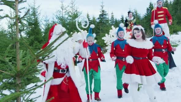 Santa Claus and his helpers dancing