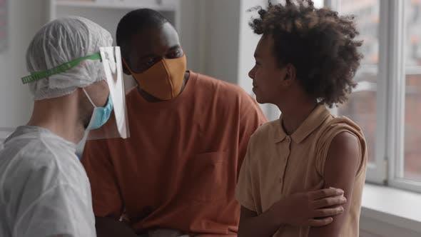 Boy High-fiving Medical Worker