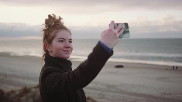 Thumbnail for Redheaded Girl Taking Selfie At Beach