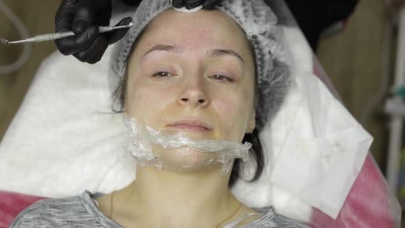 Cosmetologist Make Facial Cleaning Cosmetology Skin Acne Procedure on Woman Face